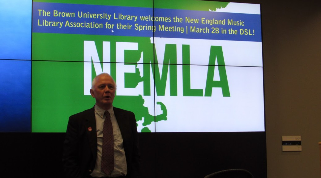 Ned Quist in front of NEMLA screen