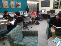 Students working in Paddock Music Library