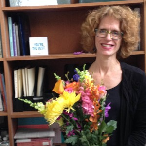 Pam Bristah receiving flowers from NEMLA. Photo courtesy of Kerry Masteller.